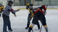 Matthew Savage of the Hawks(right) and his opponent anticipates the puck from the referee in the ASHL face off