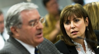 Councillor Maria Augimeri, who voted against firing TTC chief GM Gary Webster, stares down fellow councillor and TTC commissioner Frank Di Giorgio, who voted to terminate Webster's contract. Following a three-hour closed-door meeting at City Hall today, the commission voted 5-4 to fire Webster.