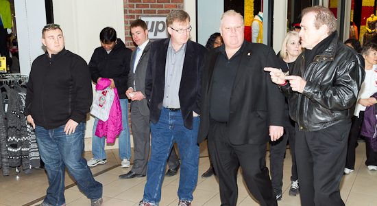 Mayor Rob Ford (second from right) talks with councillors Gary Crawford (centre) and Norm Kelly (right).