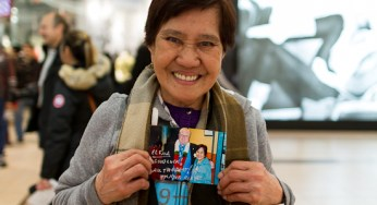 Elena Pablo poses with the photo she had signed by Mayor Mayor Ford Saturday at Scarborough Town Centre. The photo was taken with the mayor and Councillor Raymond Cho in 2010.