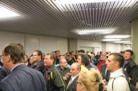 TTC workers gathered to hear Bob Kinnear address the media outside committee room one.