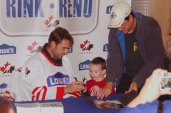 Curtis Joseph signs an autograph for a young fan who wants a memento of the fun filled day.