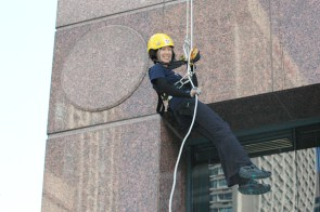 This participant is all smiles as she nears the bottom of the 17-storey rappel.
