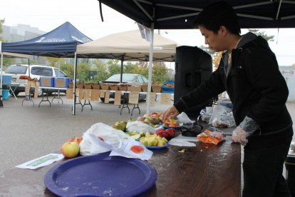 Temporary student vendor quickly sets up before the start of UTSC Farmers' Market