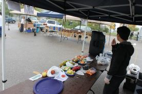 UTSC students try their hand at selling apples despite rainy weather.
