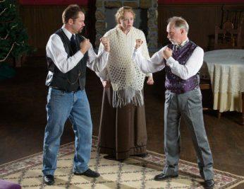 Sandy Stevens (left) prepares for a brawl with Jeremy Henson (right) over the fair Julie Jarrett (middle)