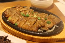 Pork marinated in soy sauce (yang-nyum galbi)