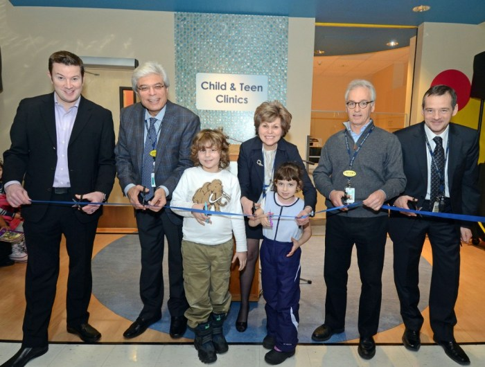 The adults helping to cut the ribbon to Toronto East General Hospital's new Child and Teen Clinic included Ken Reid, Dr. Constantine Petrou, Linda Young, Dr. Marty Perlmutar and hospital CEO Rob Devitt.