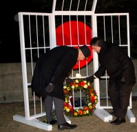 NDP MP's Matthew Kellway and Dan Harris lay a wreath down at the memorial monument.