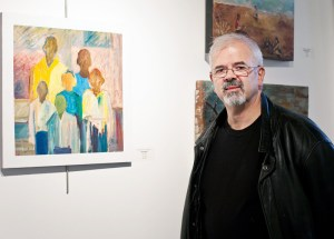 Richard Comparey with his painting Nostalgia.
