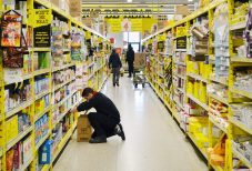 A No Frills grocery associate stocks up shelves in the bakery aisle in Scarborough Ontario.