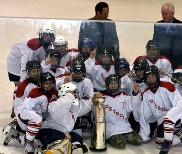 "The winners of the EYHA's ""Little Stanley Cup"" celebrate their victory. (Hasan Zahid/Toronto Observer)"