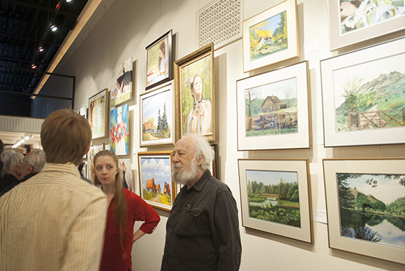 John Smith and students with some of their art. (Tichaona Tampambwa/Toronto Observer)