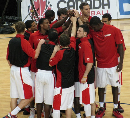 Members of Team Canada get together at mid-court prior to their game with Jamaica. Photo: Paul McGaughey
