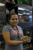 Alexandra Hassan, worker at All Reptile holds one of her favourite snakes in the store.