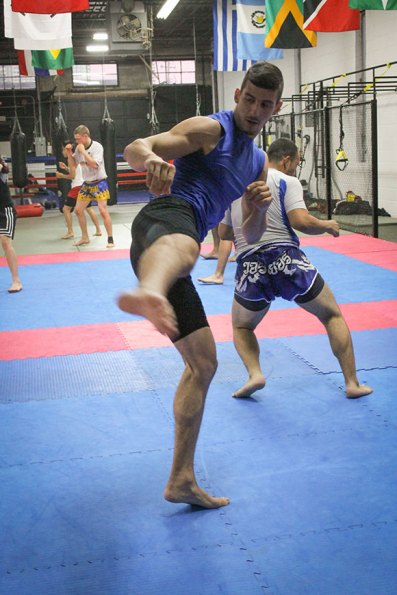 'Jab, followed by jab through to kick,' master Lou Milonas directs his students during practice at Team UMAC MMA & Fitness.