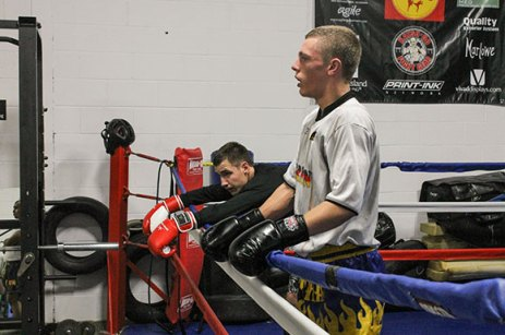 A pair of trainees take a breather after practice at Team UMAC MMA & Fitness.