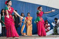 Rumainaisa Rahman, left, and Intisaar Najmeen perform a Bengali dance at the Toronto Mela Festival 2013.