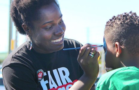 Chavenne Stamp, 26, face painting at the Jane-Finch minimum wage 'street party'.