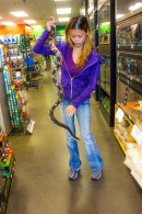 Karen Truong holds one of the longest snakes in the store.