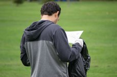 Racer looks over his map to plan out his route through the park.