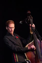 In addition to playing bass, Creeggan also lends his voice to some of the band's songs.