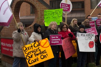 Members of the Scarborough Health Coalition protest in front of MPP Mitzie Hunter's office at 4117 Lawrence Ave. E. on Nov. 9.