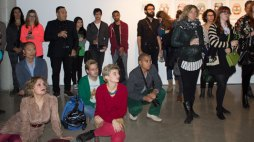 The crowd listens to curator Suzanne Carte explain how the show came together