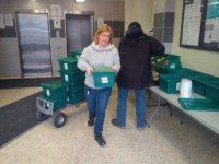Andrea Klar, a volunteer food leader, helps set up the weekly Mobile Good Food Market at Mornelle Court.