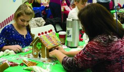 Chelsea Ingham, left, and her mother Jen at the 11th annual Gingerbread Build organized by Habitat for Humanity.
