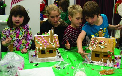 From left: Eliza Zazhariah, Madeleine Forbes, Calder Forbes and Huge Zachariah at the 11th annual Gingerbread Build organized by Habitat for Humanity.