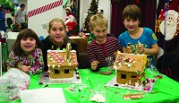 (From left to right) Eliza Zazhariah, Madeleine Forbes, Calder Forbes and Huge Zachariah at the 11th annual Gingerbread Build organized by Habitat for Humanity.