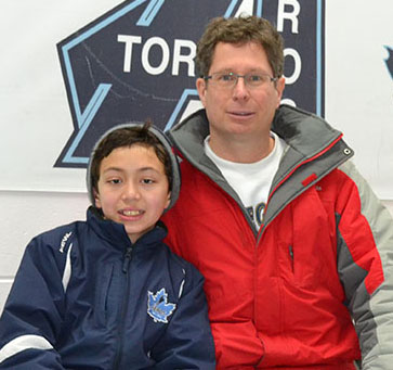 Matthew Gleeson, left, with his dad, Robert Gleeson, after a weekend game. Robert Gleeson believes playing hockey teaches son Matthew important life skills.