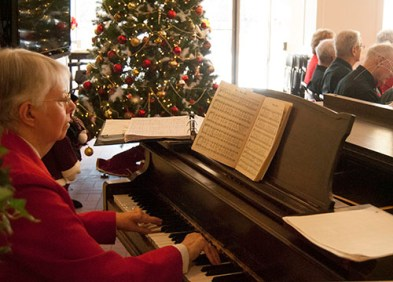 The choir's substitute pianist plays an rendition of all the well-known Christmas carols.