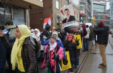 A protester is holding up a poster of President Mohamed Morsi.