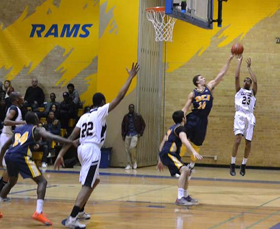 Eastern Commerce Saints' Tavon Ross (No. 23) completes play in Toronto City championship against Oakwood Barons on Thursday.
