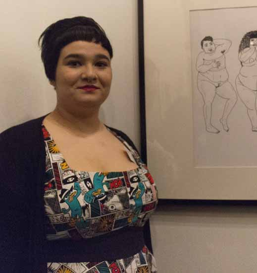 Sam Abel showcases her drawing 'Gravitas' at the Fat in Public Art Exhibit.