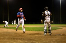 Mike Evans, left, scores to take the lead 3-2 in the top of the fifth.