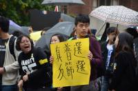 University of Toronto student Colin Shem said he joined the protest to support democracy for people around the world.