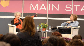 Margaret Atwood Shows off her shark gloves to a fan at the INSPIRE! Toronto International Book Fair