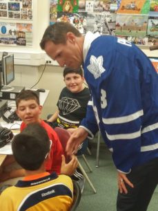 Toronto Maple Leafs captain Dion Phaneuf shakes hands with a young fan.