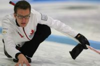 Brendan Bottcher throwing a stone at the World Junior Curling Championships.