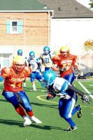 Birchmount kick returner Josh Chanderbhan-Ally (95) makes a move to get away from Northern's Ahmad Imtiaz (44).