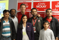 Successful Liberal candidate John McKay poses with supporters Monday night.