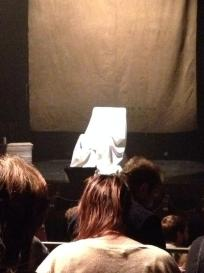 A spotlight on a white-sheet covering a rocking chair #ThingsAreGettingCreepier #TheSeance