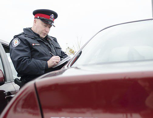 Const. McCabe isn't writing a ticket. He's letting someone who's parked at the Scarborough GO station know about the state of their vehicle.