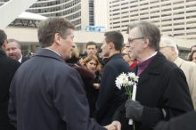 Mayor John Tory shakes the hand of a man attending the ceremony.