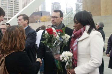 French Consul General Mr. Marc Trouyet recieves flowers from attendees.