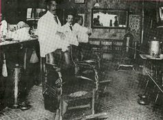 Charles Duval, left, and Fred Bolin in the Barbershop established by Charles' father, about 1895