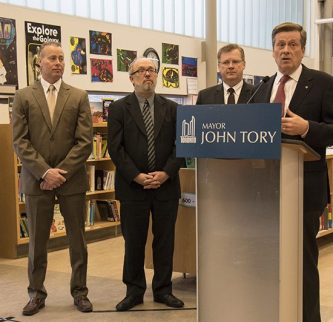Mayor John Tory and city officials address media at Thorncliffe Public School.